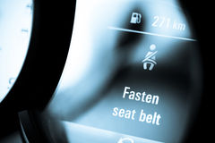 Fasten your seat belt. Detail on the dashboard of a car displaying a Fasten seat belt notification Stock Photo