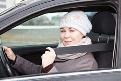 Fastened young woman sitting in car Royalty Free Stock Photo