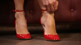 Fastenering red patent shoes stock video