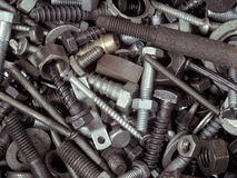 Fasteners. An assortment of bolts, screws, nuts, washers and all kinds of other fasteners piled in a toolbox royalty free stock photos