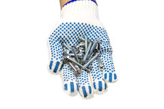 Fasteners in hand. Screws, bolts and hand in glove on white background stock images