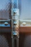 Fasteners plastic organic glass Royalty Free Stock Image