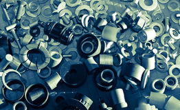 Fasteners and retro electronic components. Multitude of metal rivets shot with retro electronic components Stock Photos