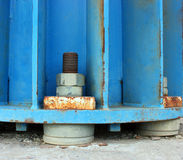 Fasteners - screws and nuts on quadratic concrete base Stock Images