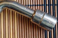 Fastenerson гаечного ключа с Torx гнездом на деревянной предпосылке, части ключа Стоковое фото RF