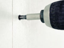 Fastening Drywall. Driving a screw into drywall Royalty Free Stock Images
