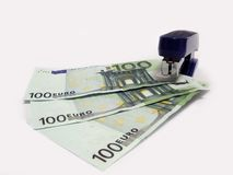 Fastening of the finance. Money fastened by a stapler Royalty Free Stock Photo