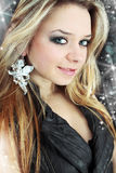 Fastening in the form of the ange. Blonde with the fastening in the form of the angel stock photography