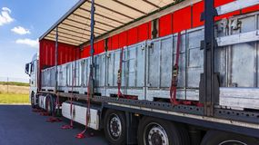 . fastening of freight in the trailer . distribution warehouse . Transportation . There is a loading to the truck trailer . Truck Trailer . Cargo Transportation stock images