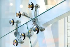Fastening of glass walls. Architecture abstract background. Glass curtain walls. The elements of the fastener system metal glass stock photo