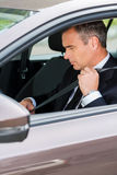Fastening his seat belt. Royalty Free Stock Photography