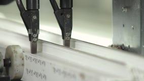 Fastening metal skeleton inside plastic profile. Fastening of a metal skeleton inside plastic profile. PVC window production technology. Factory for PVC windows stock footage