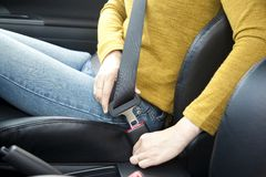 Fastening a seat belt Royalty Free Stock Image