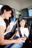Fastening seat belt in a car Stock Images