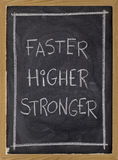 Faster, higher, stronger on blackboard royalty free stock photos