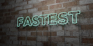 FASTEST - Glowing Neon Sign on stonework wall - 3D rendered royalty free stock illustration Royalty Free Stock Photography