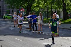 Riga, Latvia - May 19 2019: Fastest runners arriving to first refreshment point stock images