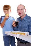 Fastfood. Father and son eating pizza and drinking coke Stock Images