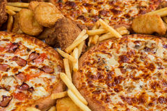 Fastfood chicken nuggets, legs, pizzas and fry potatos Stock Photo