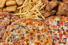 Fastfood chicken nuggets, legs, pizzas and fry potatos. Group of fastfood - chicken nuggets, legs, pizzas and fry potatos Stock Image