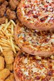 Fastfood chicken nuggets, legs, pizzas and fry potatos. Group of fastfood - chicken nuggets, legs, pizzas and fry potatos Stock Photos