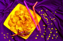 Fastfood of chips for the weekend and a holiday movie Stock Photos