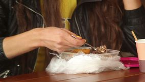 Fastfood eater, young adult woman eats fast food meal, drinks stock video