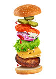 Fastfood - flying ingredients of hamburger. Royalty Free Stock Image
