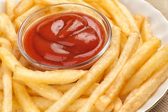 Fastfood. French fries. Fast food. French fries and tomato sauce Royalty Free Stock Photos