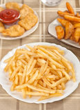 Fastfood. French fries. On a plate Royalty Free Stock Photo