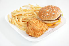 Fastfood. Fried chicken and hamburger with French Fries on white table in the morning Stock Photos