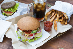 Fastfood with fries and hamburgers Royalty Free Stock Photo
