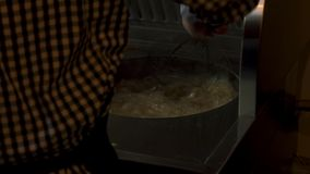 Fastfood kitchen -preparation potatoes frying in the oil, 4k footage, stock footage