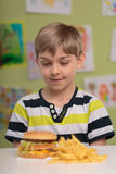 Fastfood for lunch. Greedy little child and fastfood for lunch stock images