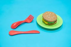 Fastfood model. Fastfood model with hamburger chesse on plastic blue table background, play dought at home, child care cooking food model, educational toys for royalty free stock photography