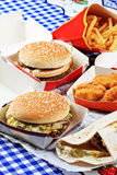 Fastfood on tablecloth. Various fastfood on blue tablecloth view from above royalty free stock photos