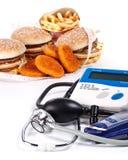 Fastfood und medizinische Hilfsmittel Stockfotografie
