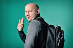 Fastidious man with a backpack Royalty Free Stock Image