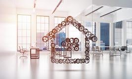 Fastighet- eller konstruktionsidé som framläggas av den hem- symbolen på vit kontorsbakgrund Fotografering för Bildbyråer