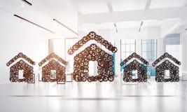 Fastighet- eller konstruktionsidé som framläggas av den hem- symbolen på vit kontorsbakgrund Arkivfoton