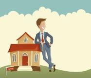 Fastighetsmäklare och hus Arkivfoto