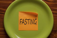 Fasting written on note Concept Royalty Free Stock Image