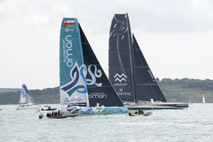 Fastnet Yacht Race off Cowes UK. Yachts Sultanate of Oman 07 OMA and Genes X Mirabaud 1819 Zenith at the start of the Rolex Fastnet Race at Cowes Isle of Wight Royalty Free Stock Image