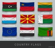 Fastnitat landets rynkade flagga med skuggor och skruven Arkivbilder
