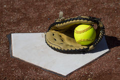 Fastpitch Catchers Mitt With Ball On Homeplate Stock Photo