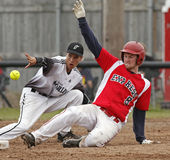 Fastpitch softball men slide throw Royalty Free Stock Image