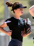 Fastpitch softball player focused on the game stock image