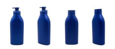 Fastställd blå flaska av kräm Fotografering för Bildbyråer