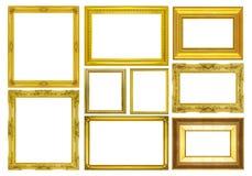Fastställd guld- ram på vit bakgrund Arkivbild