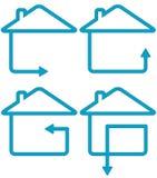 Fastställd hussilhouette och flyttningpil Arkivfoto